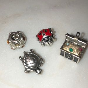Four Zable Sterling Silver Charms